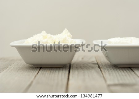 cottage cheese and creme fraiche, rustic wooden table background