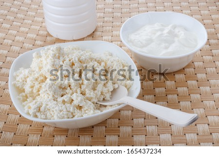cottage cheese and sour cream in white bowls