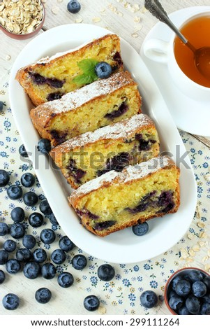 Cottage cheese cake with oat flakes and blueberries, tea - stock photo