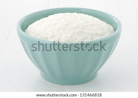 Cottage cheese can be a healthy part of your weight loss plan, and it is a staple in many health conscious diets. - stock photo