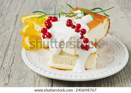 cottage cheese casserole, fresh fruit and berries on a plate on a wooden background. health or diet concept