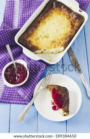cottage cheese casserole piece with jam on a plate.