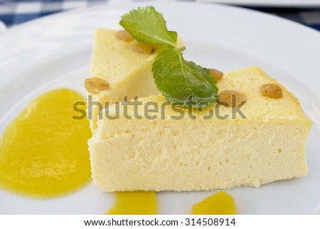 Cottage cheese casserole with peach jam and mint listochnom. Very tasty dessert. Tasty food. Dinner, lunch, a snack or breakfast. - stock photo