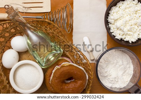 Cottage cheese dough with ingredients and finished products, donuts dough with cheese. - stock photo