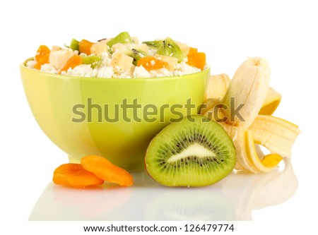 Cottage cheese in color bowl with exotic fruits, isolated on white - stock photo