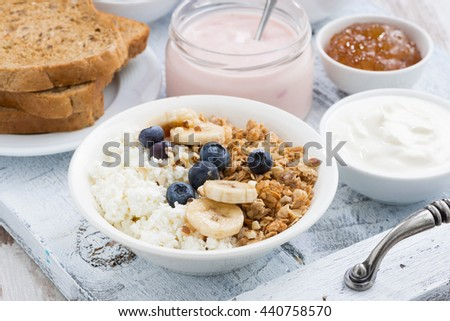 cottage cheese, muesli and fresh fruit for breakfast, closeup - stock photo