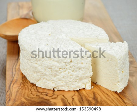 Cottage cheese on a brown table - stock photo