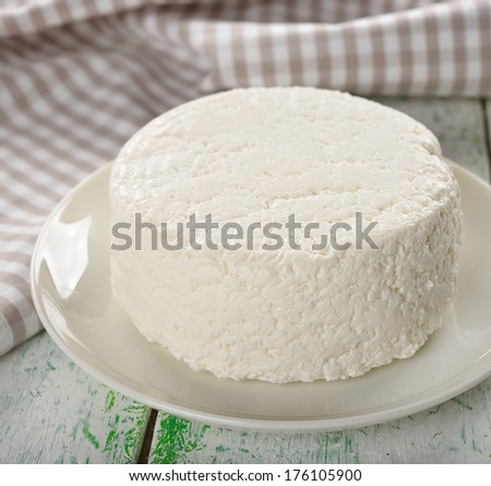 Cottage cheese on a white table - stock photo