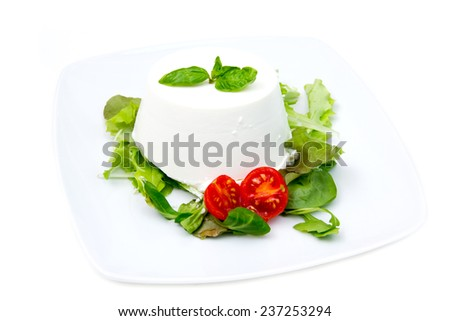 Cottage cheese on plate on white background - stock photo