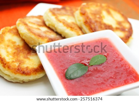 Cottage cheese pancake with strawberry jam - stock photo