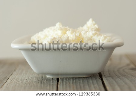 cottage cheese, rustic wooden table background