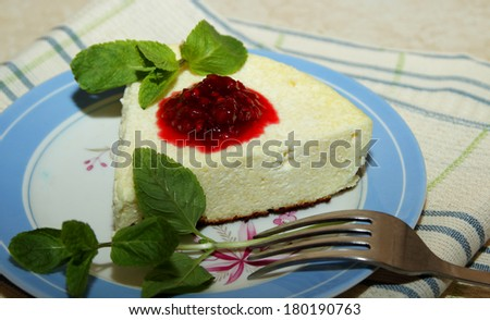 Cottage cheese souffle with raspberry jam and a sprig of mint on the plate