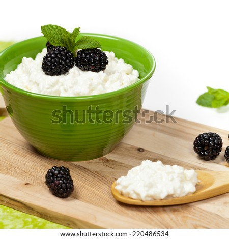 Cottage cheese with fresh blackberries. Selective focus. - stock photo