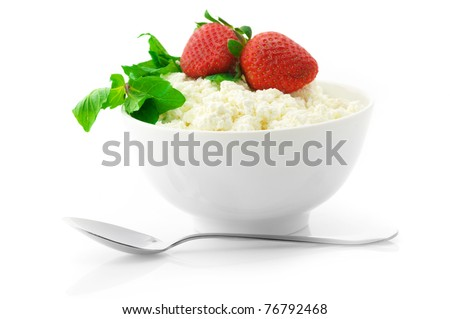 Cottage cheese with mint and strawberries in white bowl  isolated on white background. - stock photo