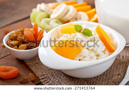 Cottage cheese with orange for breakfast close up - stock photo