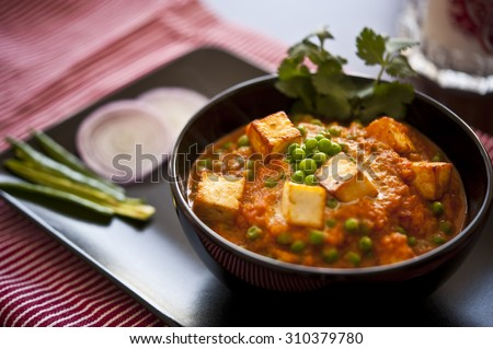 Cottage cheese with Peas in Indian Gravy - stock photo
