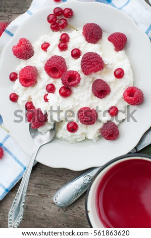 Cottage cheese with raspberry and currant. Dessert with berries