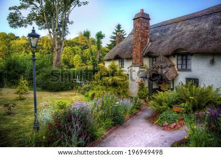 Cottage in a British Village - stock photo