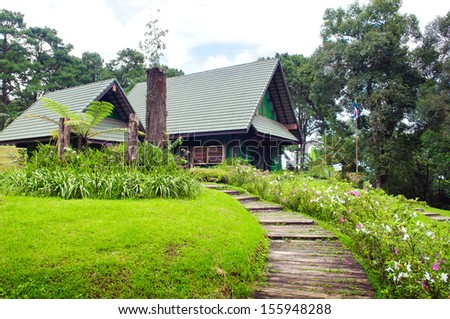 Cottage in forest - stock photo