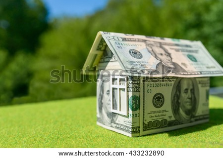 Cottage made of dollar banknotes, housing loan.  - stock photo