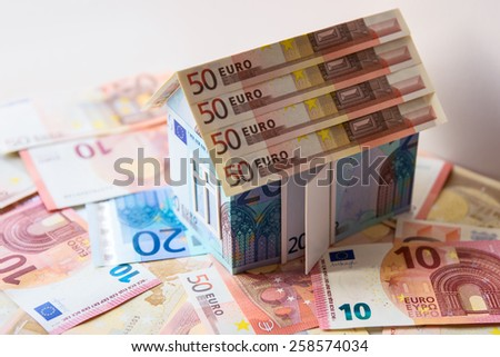 Cottage made of euro banknotes, housing loan.  - stock photo