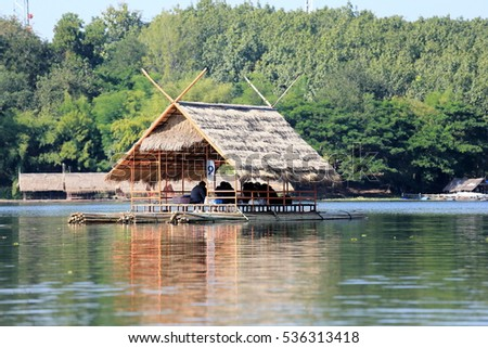 Cottage on bamboo rafts in the reservoir.
