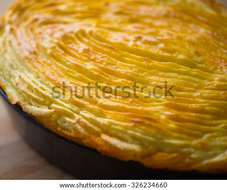 cottage pie in a rustic baking dish - stock photo