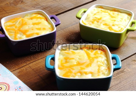 Cottage pie served in individual casseroles - stock photo