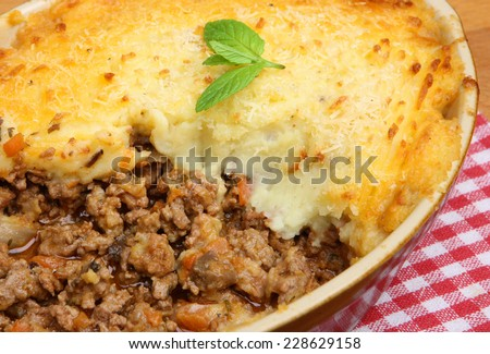 Cottage pie straight from the oven - stock photo