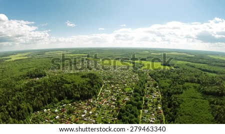 Cottage village among forest at summer sunny day. Aerial view - stock photo