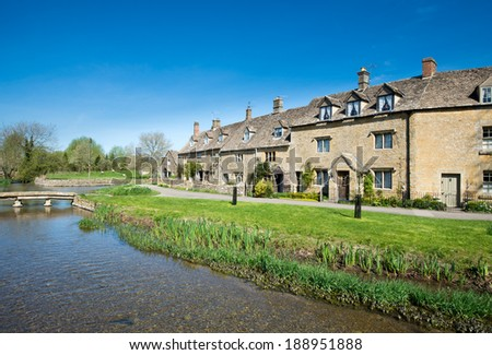 Cottages by a stream in the Cotswold village of Lower Slaughter - stock photo