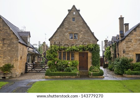 Cottages in the village of Broadway, Cotswold - United Kingdom on a rainy day. - stock photo