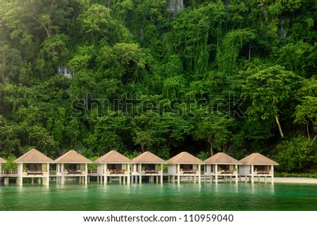 Cottages on stilts in El Nido, Palawan, Philippines - stock photo