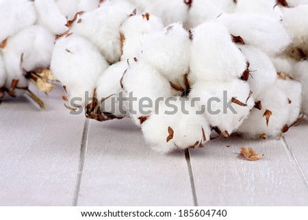 Cotton balls on wood  - stock photo