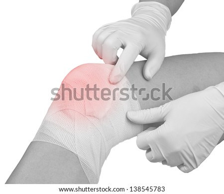 Cotton bandage over a wound on knee. Pain concept photo.