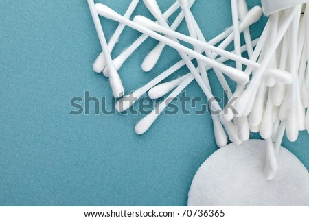 cotton discs and sticks, blue background