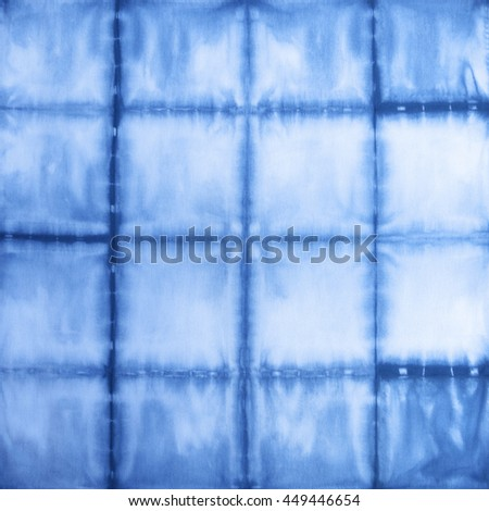 Cotton fabric tie-dyed using indigo blue dye.