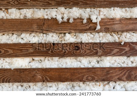 Cotton overflowing from an old wooden wagon - stock photo