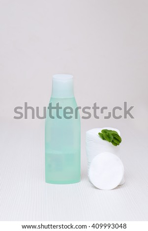 cotton pads and tonic for washing - stock photo