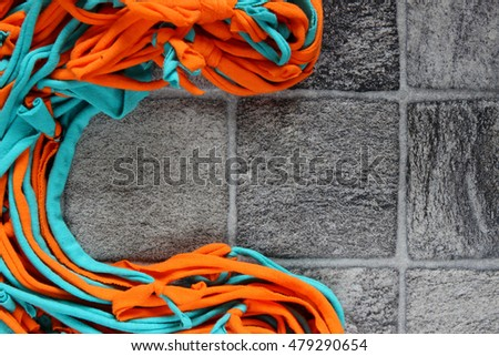 cotton ribbons on gray background. for background and text