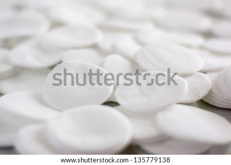 Cotton round cosmetic pads, evenly distributed - stock photo