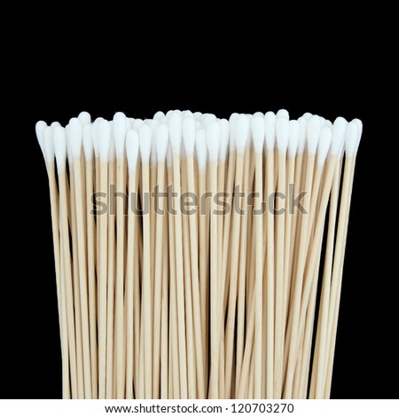 Cotton swabs isolated on black background