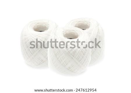Cotton thread ball on white background - stock photo