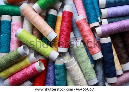 Cotton threads in a large assortment of colors, suitable for a wide range of sewing or embroidery projects - stock photo