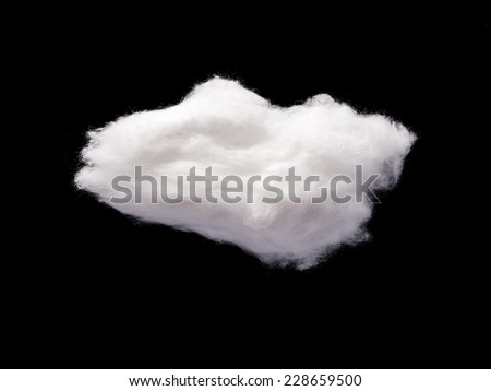 Cotton Wool Cloud isolated in Black Background with Text Space. Clouds Made of Real Cotton - stock photo