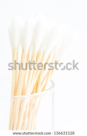 Cottonbud with cotton wool in glass - stock photo