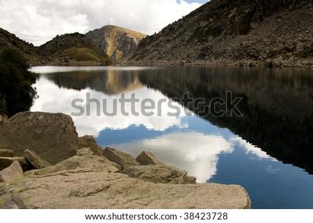 Couart lake, Andorra Pyrenees mountain. Autumn day. - stock photo