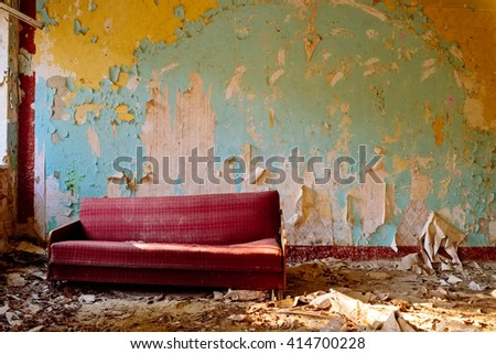 Couch in abandoned room - stock photo