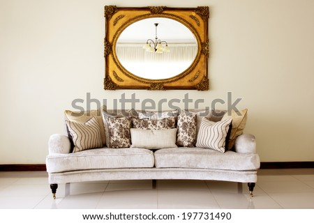 Couch with Mirror / Modern Couch with Cushions and Antique Mirror - stock photo