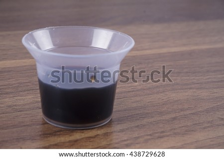 Cough medicine isolated on wooden table.